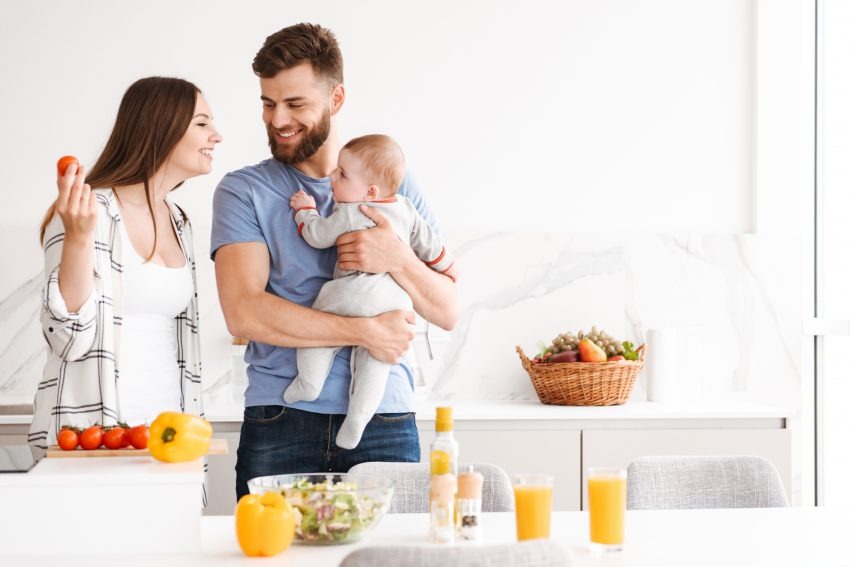 BankingDeal.com - Amazing parents with their baby son cooking in kitchen.